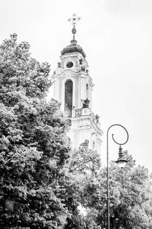 Vilnius, Lithuania: Street lantern, tree crowns and a top part of the tower of the Church of St. Catherine. This church was built in 1743 and was a part of Benedictine monastery.