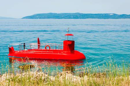 Bright red tourist submarine in Adriatic sea waters
