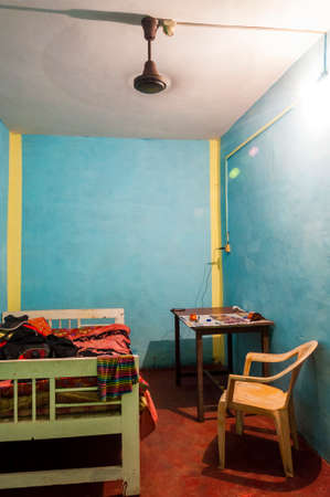 Here you can see a standard, low quality and service free, cheap room in Goa. Just a bed, table, chair, vent and one electric socket.