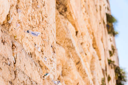 Letters to God shoved between the stones on Western Wall in Jerusalem