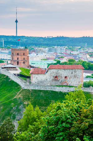 Vilnius, Lithuania - May 15, 2013: Cityscape skyline view on famous Gediminas castle complex and tv tower on the background from Three Crosses Hill panoramic viewpoint Editorial
