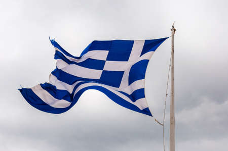 National vibrant blue and white flag of Greece fluttering waving flying in the wind on the flagpole
