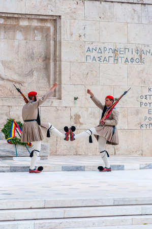 Athens, Greece - June 12, 2013: The Evzones or Evzonoi, the Presidential Guard is a ceremonial infantry unit that guards the Tomb of the Unknown Soldier and the Presidential Mansion in Athens, Greece