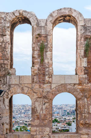 Stone arches with the view through the windows on Athens cityscape in ancient Acropolis site Фото со стока