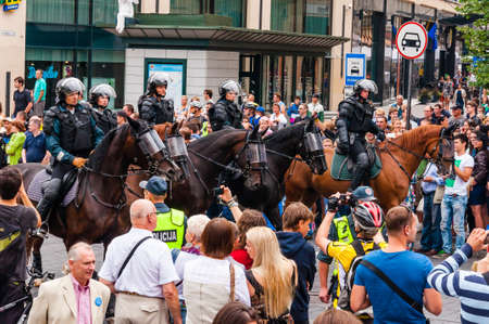 Vilnius, Lithuania - July 27, 2013: Armed mounted police forces standing at the beginning of Pride parade on Gedimino street. Event celebrating lesbian, gay, bisexual, transgender, LGBTI culture pride 에디토리얼