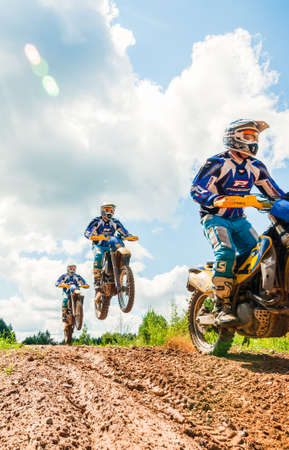 Vilnius, Lithuania - July 14, 2013: A group of amateur motorcyclists practice their manoeuvres. This is a multiple exposure shot taken on public land Editorial