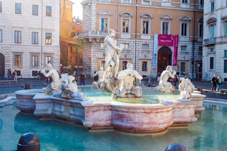 Rome, Italy - November 18, 2018: Fontana del Moro, Moor fountain located at the southern end of Piazza Navona, it represents a Moor, or African, Neptune, standing in a conch shell, wrestling with a dolphin, surrounded by four Tritons Editorial