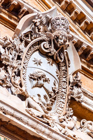 Vatican, Rome, Italy - November 16, 2018: Classical marble emblem hanging on one of the facades of Vatican museums complex buildings in Pine Tree garden