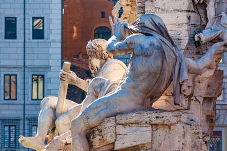 Rome, Italy - November 18, 2018: Statues of rivers gods fragments as a part of the Fontana dei Quattro Fiumi, Fountain of the Four Rivers designed by Gian Lorenzo Bernini for Pope Innocent X Imagens