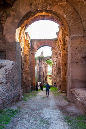 Rome, Italy - November 17, 2018: People in arches gallery hall in Domus Severiana which is the modern name given to the final extension to the imperial palaces on the Palatine Hill in Rome