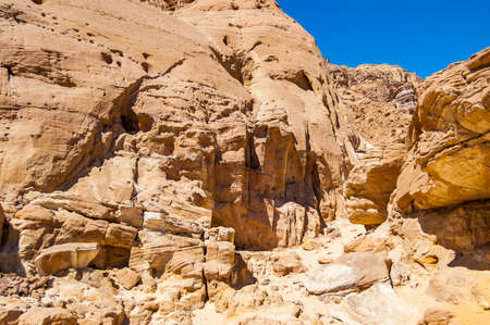 Interesting shapes trails surrounded by caves, rocks, cliffs of ancient cooper mines canyons and mountains range in Timna National Park in Israel