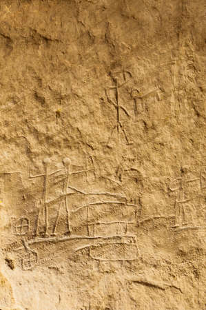 Ancient carving on the rocks, parietal art, cave painting, rock drawing in the Timna National Park, desert of Aravah valley in Israel Stock Photo