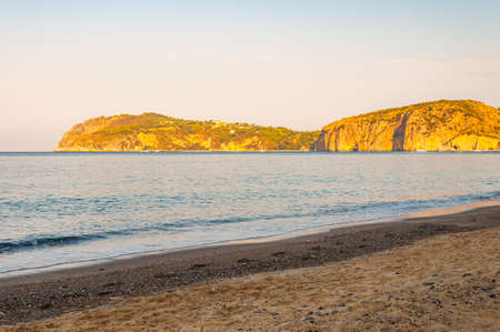 Morning sand beach on Tyrrhenian sea coast with mountains on background in Cilento Vallo di Diano and Alburni National park in province of Salerno, Campania region, Italy