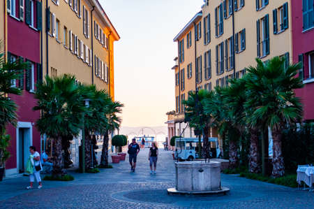 Sirmione, Lombardy, Italy - September 12, 2019: People walking around by the streets of the famous Old Town of Sirmione city located on peninsula of Garda lake in Lombardy, Italy