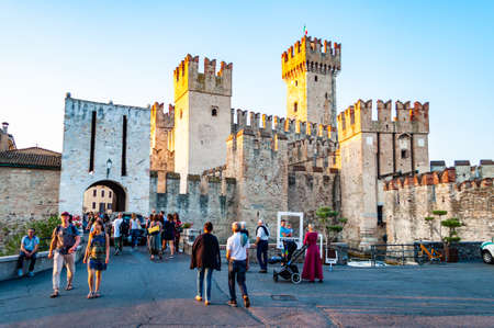 Sirmione, Lombardy, Italy - September 12, 2019: The Scaligero Castle is a fortress from the Scaliger era, access point to the historical center of Sirmione one of the most complete castles in Italy.