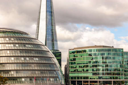 London, United Kingdom - September 14, 2017: Forecast cloudscape above City Hall, The Shard skyscraper and other famous building of London