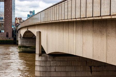 London, United Kingdom - September 14, 2017: Close up of London bridge design. Heavy foundation hold curved arcs of concrete construction above Thames river