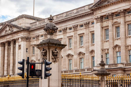 London, United Kingdom - September 14, 2017: Famous and the main symbol of London Buckingham Palace. The fragment of the front facade behind the black gold metal fence