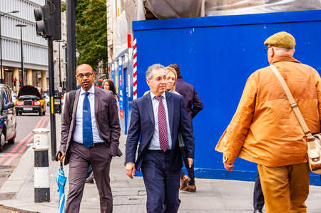 London, United Kingdom - September 14, 2017: All kinds of people crossing the road in London. People walking in downtown of London full of modern and traditional buildings, small and big businesses