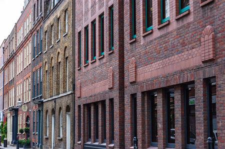 London, United Kingdom - September 14, 2017: Classic multicolor brick facades in London midtown. Vibrant architecture of United Kingdom.
