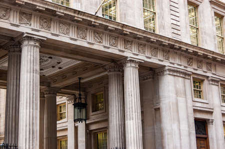 London, United Kingdom - September 14, 2017: Greek stone columns. Classical example of architecture in famous downtown of London. 新聞圖片