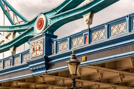 London, United Kingdom - September 14, 2017: The vibrant and colorful fragment of the famous Tower Bridge in London. Colored metal constructions of the bridge.