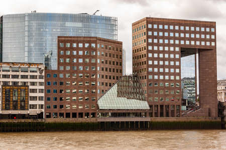 London, United Kingdom - September 14, 2017: View on London bridge hospital buildings on the shore of Thames river in London.