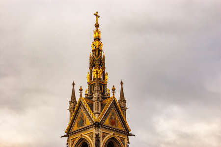 London, United Kingdom - September 15, 2017: High top of the rich decorated classic tower of the catholic church in London 新聞圖片