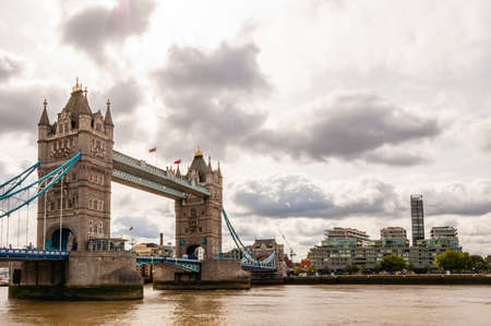 London, United Kingdom - September 14, 2017: Famous cityscape view of London. Tower bridge on Thames river with cloudy sky