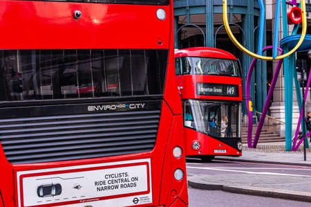 London, United Kingdom - September 14, 2017: Traditional London red buses on foreground and background in downtown
