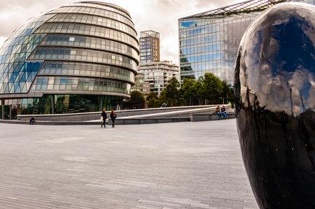 London, United Kingdom - September 14, 2017: City Hall Black Egg sculpture located on riverside promenade near the Tower bridge