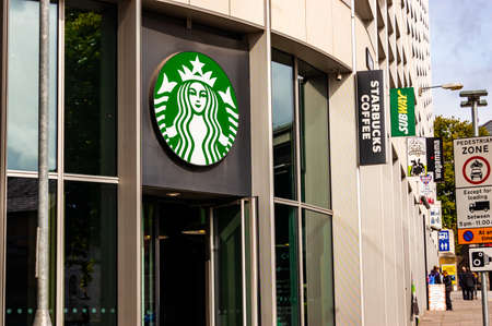 London, United Kingdom - September 14, 2017: Starbucks coffee bar outdoor logo hanging above the entrance in downtown.