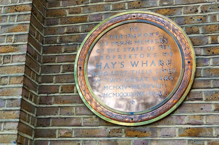 London, United Kingdom - September 14, 2017: Round memorial wall emblem in Hays Wharf dedicated to the victims of two great wars