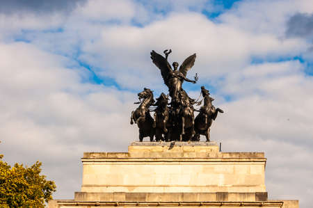 London, United Kingdom - September 14, 2017: Famous Wellington Arch monument also known as Constitution Arch or as the Green Park Arch with a black bronze quadriga on the top