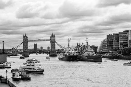 London, United Kingdom - September 14, 2017: Famous monochrome cityscape view of London. Forecast Thames river traffic full of nautical ships with amazing Tower bridge on the background