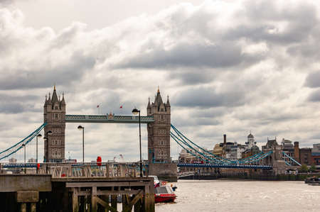 London, United Kingdom - September 14, 2017: Famous cityscape view of London. Forecast Thames river traffic full of nautical ships with amazing Tower bridge on the background