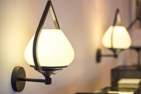 sconce: Wall lamp with yellow shade