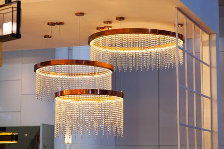 ceiling: Beautiful chandelier. luxury expensive chandelier hanging under ceiling