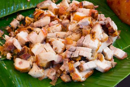 Close up Thai roasted crispy pork on banana leaf