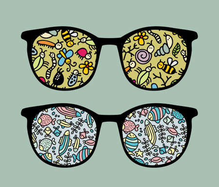 sunglasses reflection: Retro sunglasses with insects and fish reflection in it.