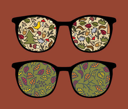 sunglasses reflection: Retro sunglasses with forest reflection in it.