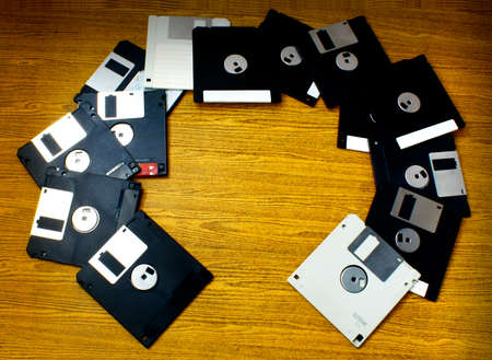 old wood floor: Old Diskettes scatter on the wood floor.