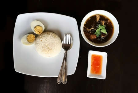 stainless: Thai food Lunch Set of Stewed pork leg on rice with boiled egg straight to the good stuff.