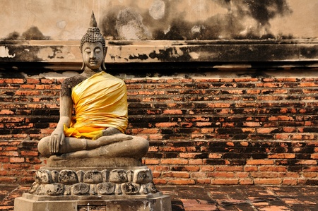 Beautiful buddha statue with brick wall Stock Photo