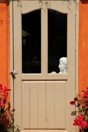 Door with human statue photo