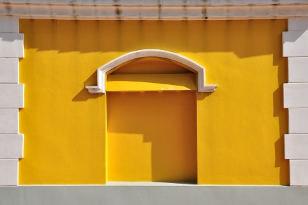 White brick frame with yellow wall European style photo