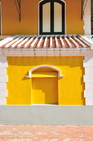 White brick frame with yellow wall and windows European style photo