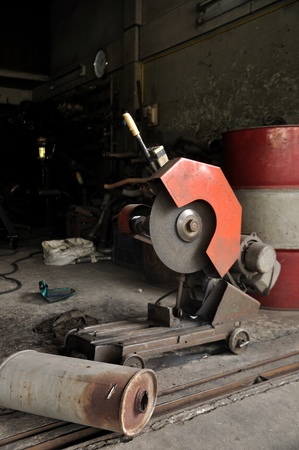 Cutting grinder and old exhaust pipe photo