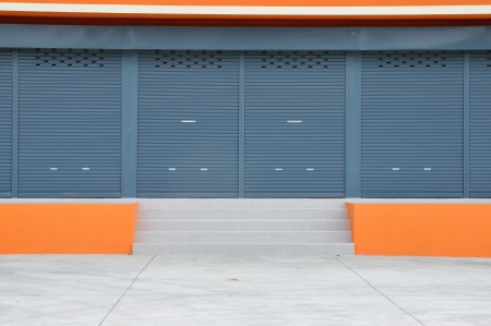 warehouse building: Closed door of new modern warehouse building