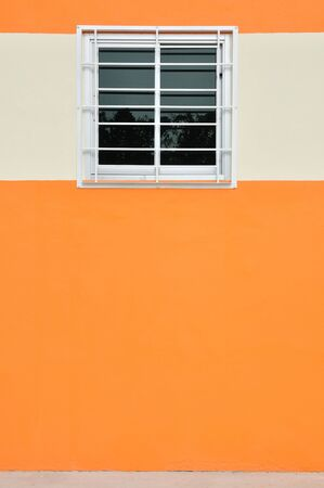 A glass window with case  on the orange wall Stock Photo - 21533145